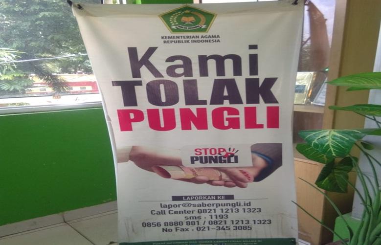 Benner Laporan Saber Pungli. Foto Diambil dari Kantor Kemenag Kota Palembang. Foto. Syf